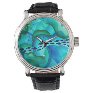 Enseñar el reloj de la acuarela de los pescados