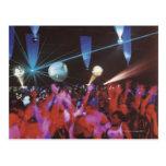 Enthusiastic crowd dancing postcard