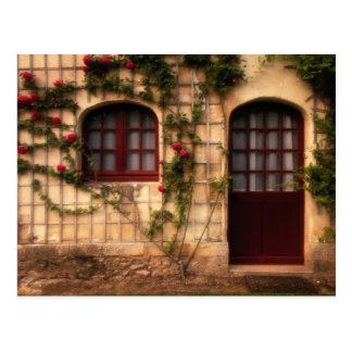 Entrada de la cabaña color de rosa postal