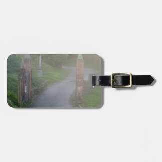 Entrance gate in the fog luggage tag