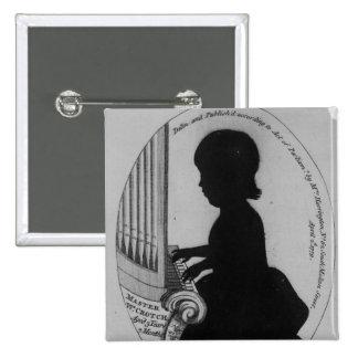Entrepierna de Guillermo que juega el órgano Pin Cuadrado