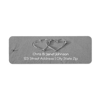 Entwined hearts in sand return address labels
