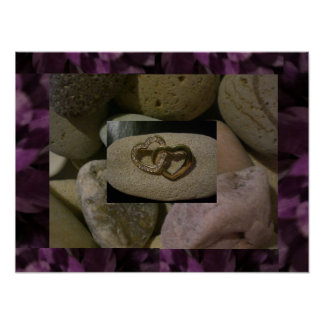 Entwined love hearts on a sea stone poster
