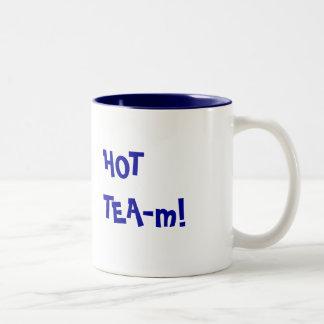 Equipo caliente - retruécano divertido del equipo taza de dos tonos