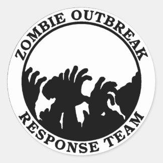 Equipo de la respuesta del brote del zombi (manos pegatina redonda