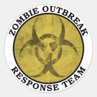 Equipo de la respuesta del brote del zombi etiqueta redonda