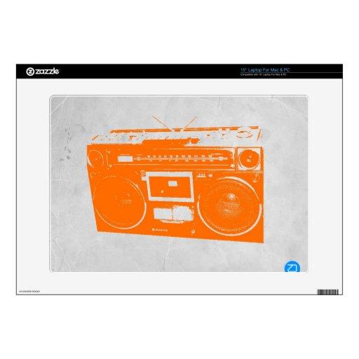 Equipo estéreo portátil anaranjado skins para portátil