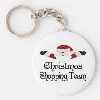 Equipo que hace compras del navidad llavero redondo tipo pin