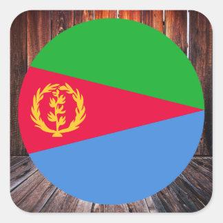 Eritrea flag circle on wood background square sticker
