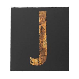 Error tipográfico J de la letra Bloc De Notas