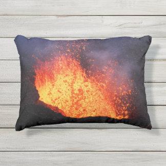 Erupting active volcano: hot lava flow in crater outdoor pillow