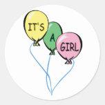 Es globos de un chica etiqueta redonda