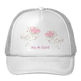 Es un gorra rosado del remolino de los corazones