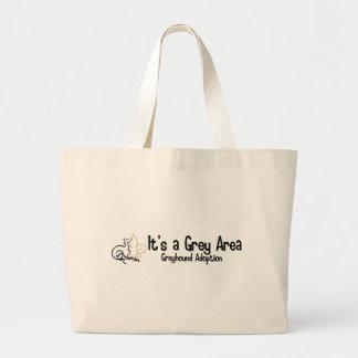 Es un logotipo del área gris - 2 bolsas lienzo