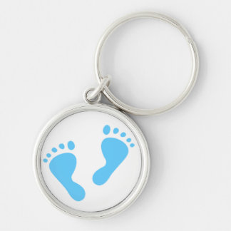 Es un muchacho - pies del bebé azul llavero redondo plateado