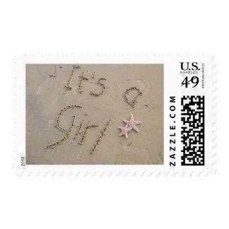 Es un sello del chica - escrito en arena