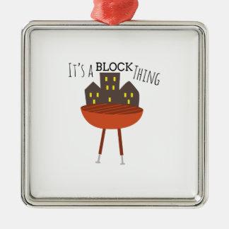 Es una cosa del bloque adorno cuadrado plateado