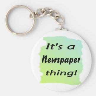 Es una cosa del periódico llavero redondo tipo pin