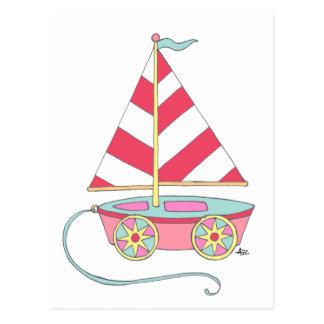 Es una postal del velero del juguete del chica