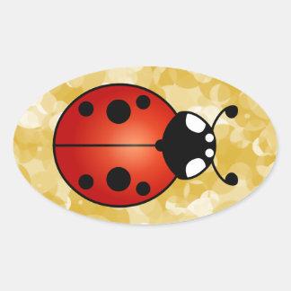 Escarabajo de mariquita anaranjado rojo de la pegatina ovalada