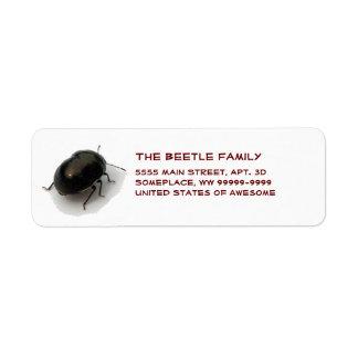 Escarabajo encapuchado minucioso negro etiqueta de remite