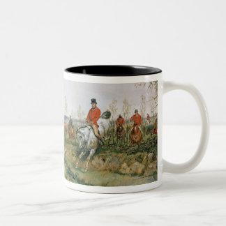 Escena de la caza taza de café