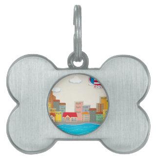 Escena de la ciudad por el río placas mascota