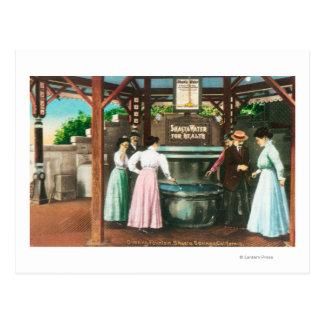 Escena de la fuente de consumición del agua de postal