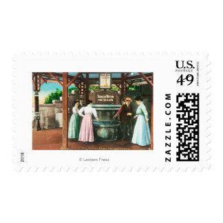 Escena de la fuente de consumición del agua de sello postal