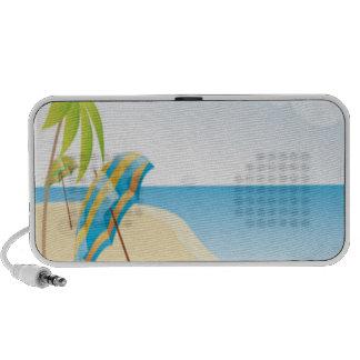 Escena de la playa con el paraguas, las palmeras y iPod altavoz