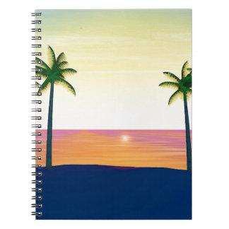 Escena de la playa de la puesta del sol libros de apuntes