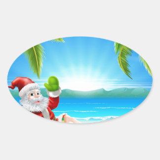 Escena de la playa de Santa del navidad del verano Pegatina Ovalada