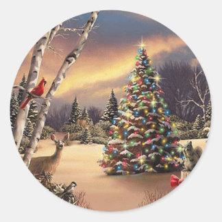 Escena del invierno del navidad pegatina redonda