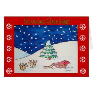Escena linda de la nieve del reno con el trineo y tarjeta de felicitación