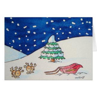 Escena linda de la nieve del reno con el trineo y tarjeta pequeña