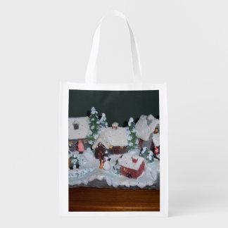 Escena sueca del invierno del día de fiesta bolsas reutilizables