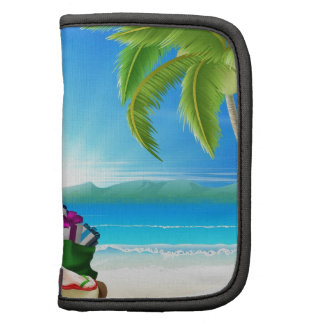 Escena tropical de la playa de Santa del navidad Planificadores