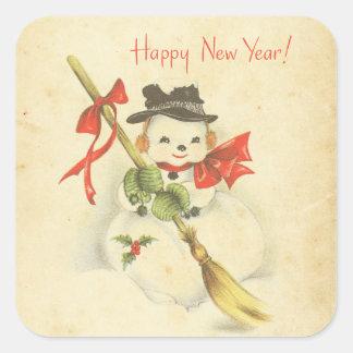 Escoba roja del acebo del arco del muñeco de nieve pegatina cuadrada