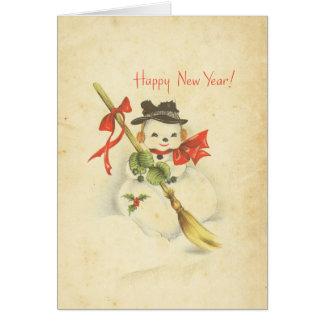 Escoba roja del acebo del arco del muñeco de nieve tarjeta de felicitación