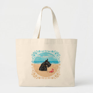 Escocés curioso en la playa bolsa