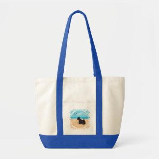 Escocés en la playa con la gaviota bolsas lienzo
