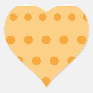 Escriba en puntos de oro suaves de la base n del pegatina en forma de corazón
