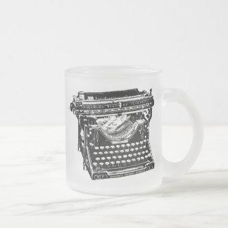 Escritor de la máquina de escribir del sotobosque taza de café