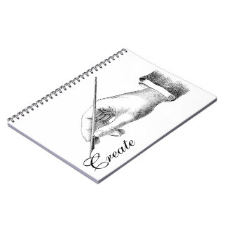 Escritura de la mano libro de apuntes con espiral