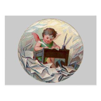 Escritura del niño del ángel del vintage en el tarjeta postal