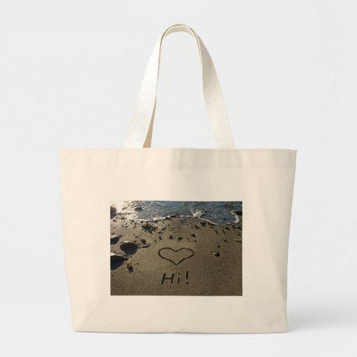 Escritura en la arena bolsas de mano