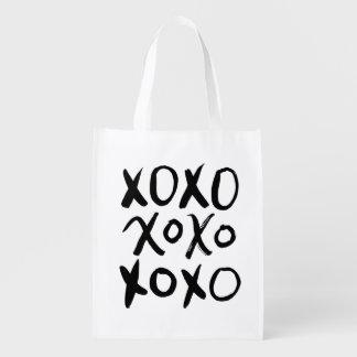 Escritura negra del cepillo de XOXO el | Bolsas Reutilizables