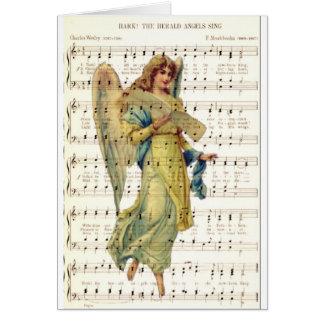 Escuche los ángeles cantan en la hoja de música de felicitacion