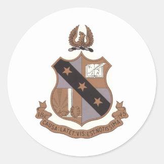 Escudo alfa de la phi de la sigma etiqueta redonda