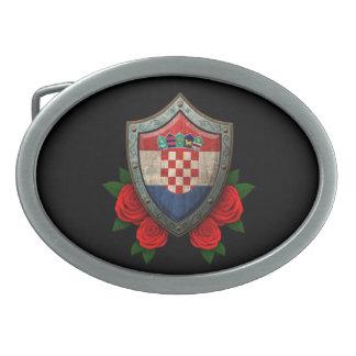 Escudo croata gastado de la bandera con los rosas  hebillas de cinturón ovales